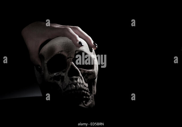 Skull Hand Holding Sto...