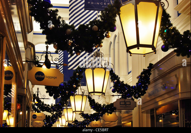 Art Deco lanterns and Christmas decorations in the very upmarket Princes  Arcade off Piccadilly, London