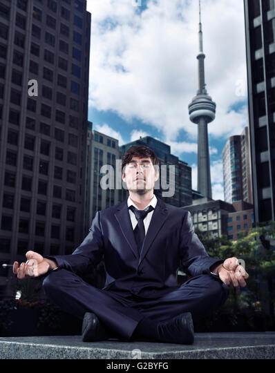 how to meditate in office. Businessman In A Suit Meditating Front Of Downtown Office Buildings And CN Tower, Toronto How To Meditate