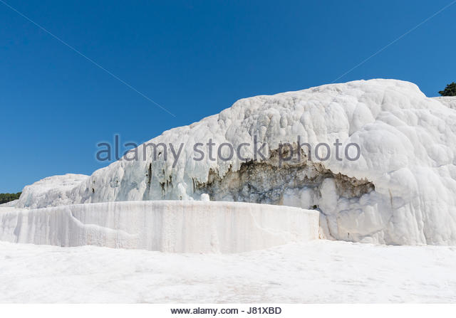Natural travertine pools and terraces at Pamukkale ,Turkey. Pamukkale, meaning 'cotton castle' in Turkish. - Stock Image