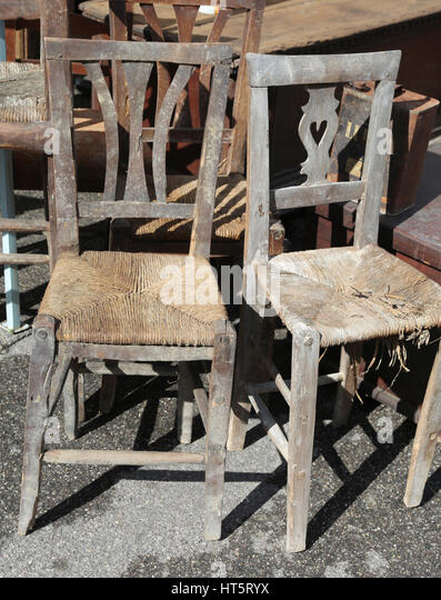 Old Wicker Chairs For Sale In The Outdoor Antiques Market   Stock Image