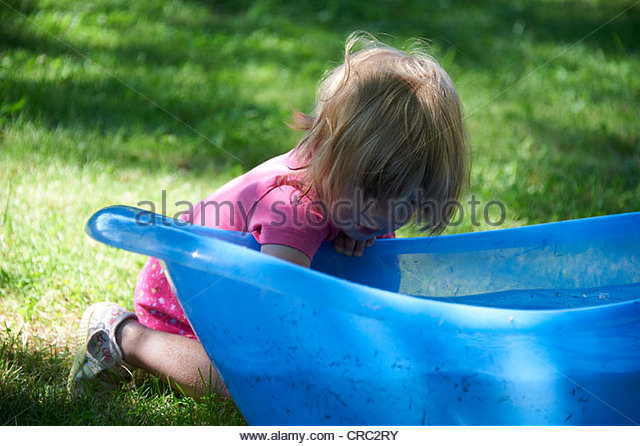 Little children playing in bath stock photos little for Baby garden pool