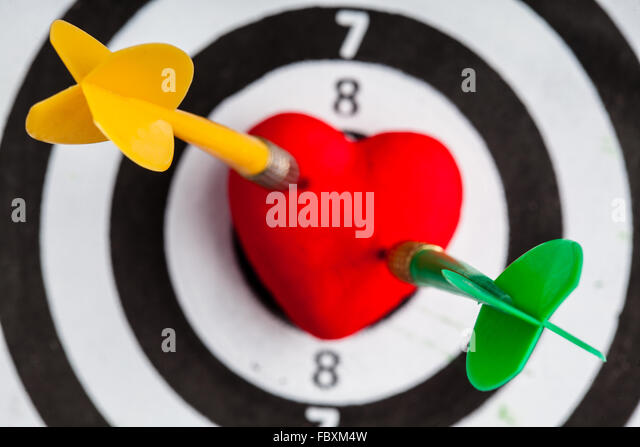 Symbol bullseye stock photos symbol bullseye stock images alamy black white target with two darts in heart love symbol as bullseye thecheapjerseys Gallery