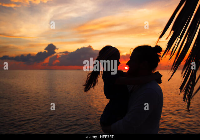 father and daughter fishing silhouette sunset