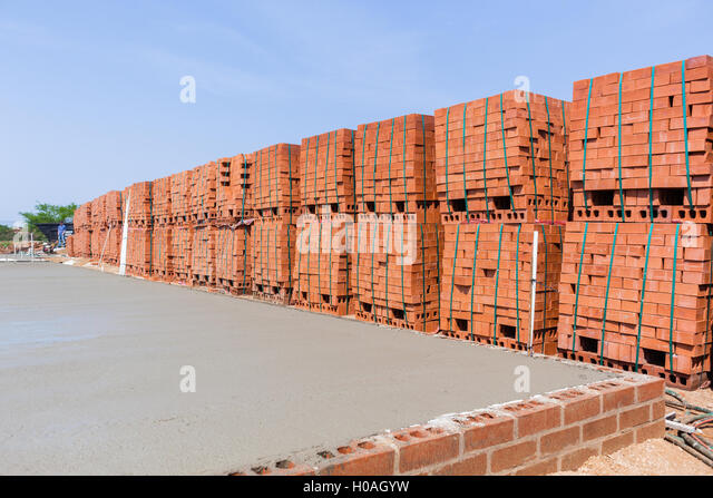 Construction Building Concrete Pouring Wet Cement Stone Wire Plastic Foundations And Bricks Stacked