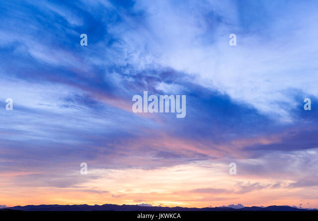 Future, time passing, new day, sky, Bright Blue, Orange And Yellow Colors Sunset sunrise - Stock Image