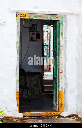 looking through an old indian village house to a back door andhra pradesh india