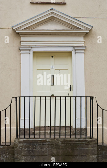 White wooden paneled front door no. 11 with handle letterbox white triangular pediment architrave of & Front Doors Railing Stock Photos \u0026 Front Doors Railing Stock Images ...
