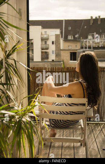 Sunbathing balcony home stock photos sunbathing balcony for Balcony sunbathing