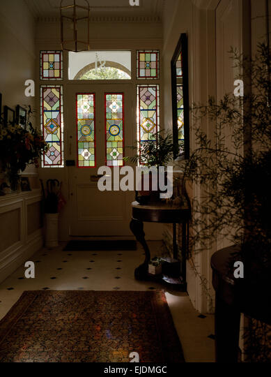 Stained Glass Panels In Front Door Of Victorian Style Hall