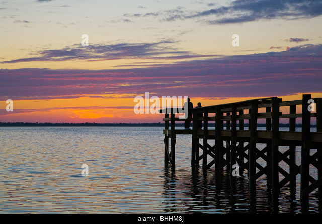 Sunset Over Gulf Of Mexico With Silhouetted Pier On Pine Island Florida