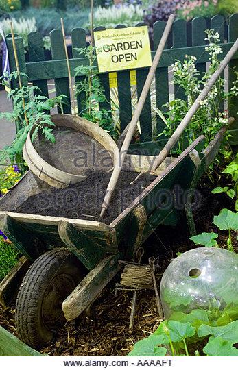 Garden old wooden wheelbarrow stock photos garden old for Vegetable garden tools