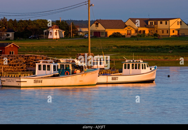 View colorful fishing boats anchored stock photos view for Head boat fishing near me