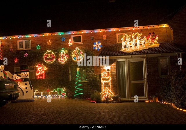Attractive Private House Illuminated By Masses Of Christmas Lights And Other  Decorations Near Evesham UK   Stock
