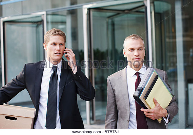 lawyers carrying files and box outside office building stock image boxes stack office file