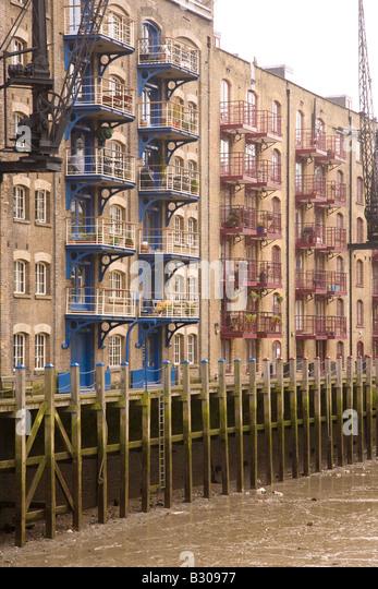 Converted warehouse apartments, South Bank, Thames, London - Stock Image