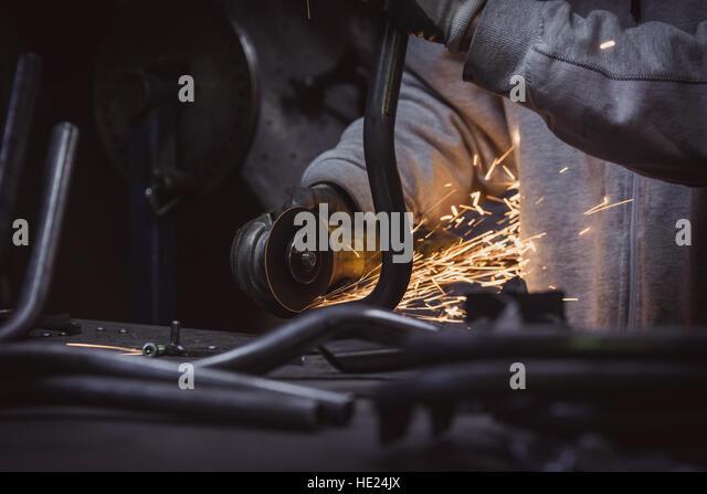 Grinding wheel worker stock photos