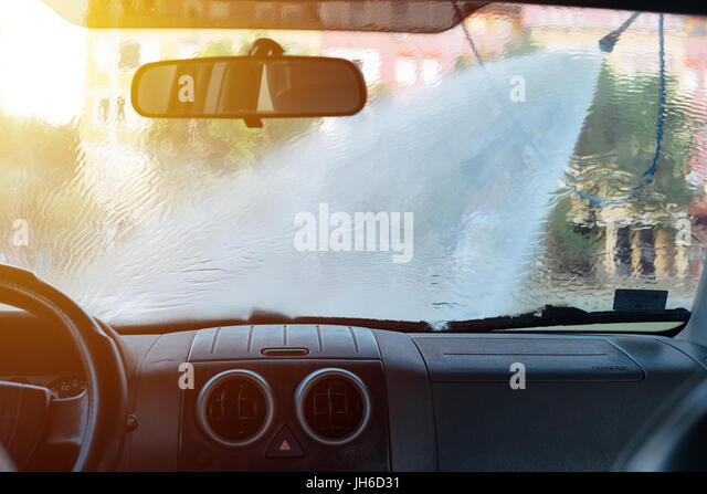 Inside car in car wash stock photos inside car in car wash stock man washing car in self service car wash station viewed from inside of the solutioingenieria Image collections
