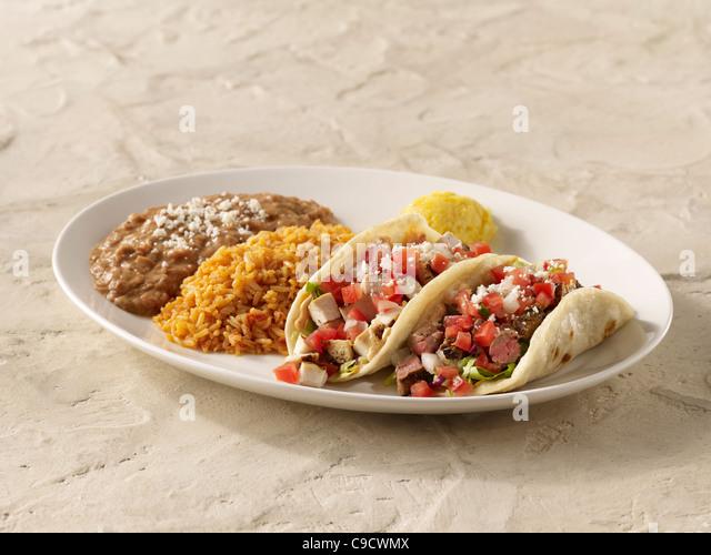 fajita chicken taco and steak taco combo topped with salsa fresca ...