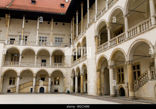The arched cloisters around the 16th Century Renaissance style courtyard.  Wawel Castle. Krakow,