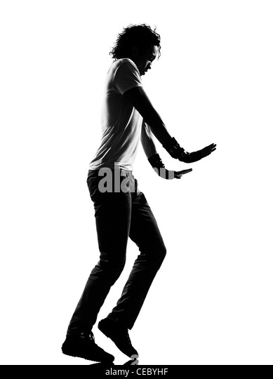 full length silhouette of a young man dancer moonwalk dancing funky hip hop rb on isolated studio white background