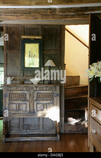 Wooden Carved Furniture Stock Photos amp Wooden Carved  : carved wooden cabinet in country hall with oak staircase and paneled dagbj3 from www.alamy.com size 347 x 540 jpeg 61kB