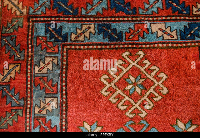 Charming Angle With Pattern Ancient Armenian Red Woolen Carpet   Stock Image
