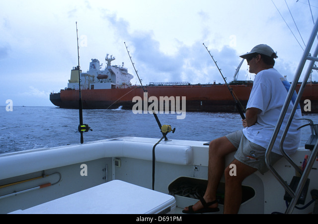 Man deep sea fishing from boat stock photos man deep sea for Deep sea fishing gulf of mexico