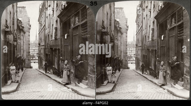 Narrow street in old latin quarter notre dame in distance paris