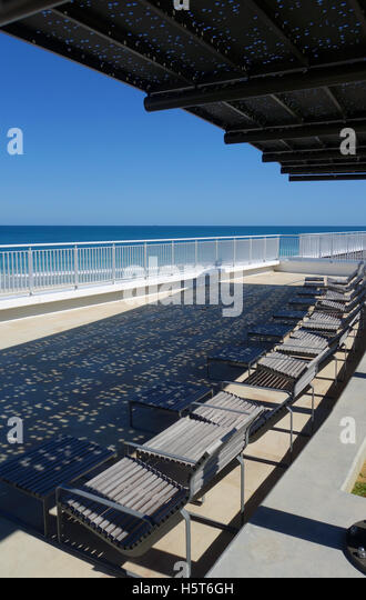 Balcony beach chair stock photos balcony beach chair for Balcony overlooking city