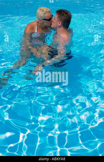 Romantic Couple Kissing Swimming Pool Stock Photos Romantic Couple Kissing Swimming Pool Stock