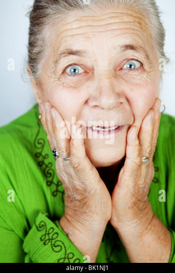 Excited senior woman w...
