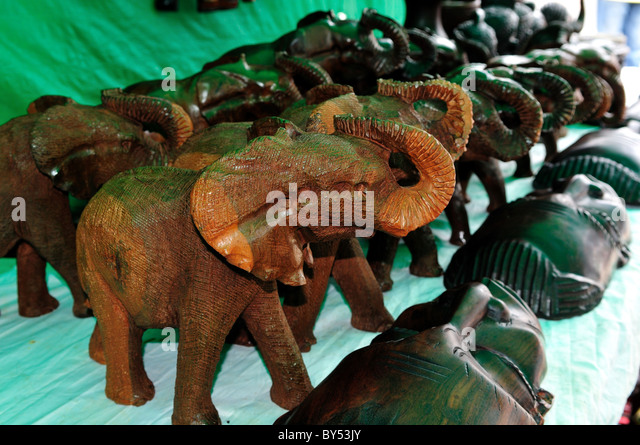 Carved african wooden souvenirs stock photos