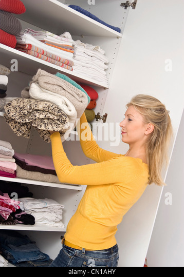 Put Clothes Away ~ Put away cupboard stock photos