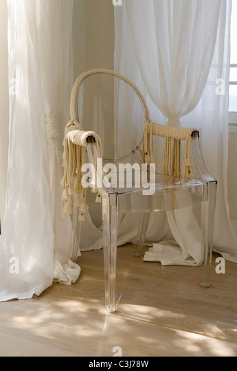 Philippe Starck Louis Ghost Chair With Detail By Isabel Marant Stock Image