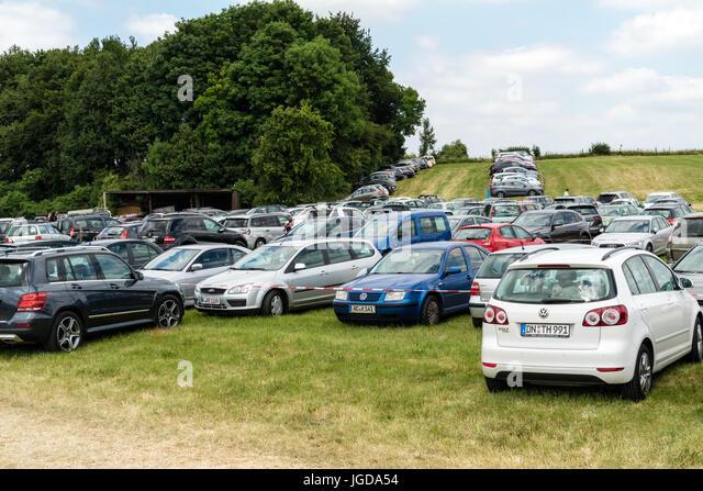 KORNELIMUENSTER, GERMANY 18th June 2017 - temporary car park on a meadow. Set up for the historic fair of Kornelimuenster. - Stock Image
