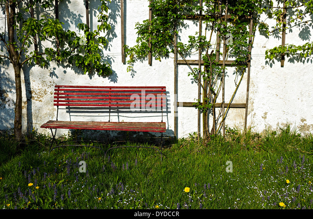 Lastest Wood Bench Against A Brick Wall Stock Photo 76311007