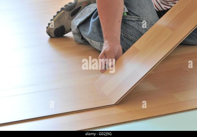 laminat verlegen stock photos laminat verlegen stock. Black Bedroom Furniture Sets. Home Design Ideas