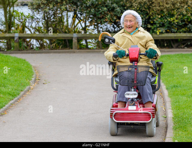 Little old lady on a motorized cart for Motorized carts for seniors