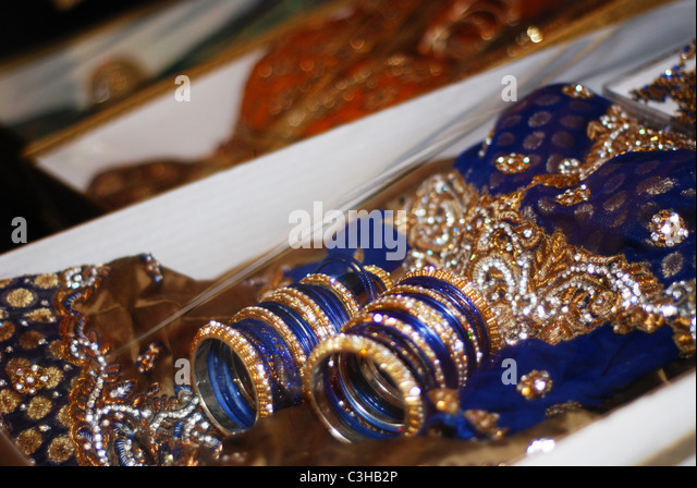 Colourful Bangles And Elaborate Clothes Assembled As Gifts For A Muslim Bride Part Of Her