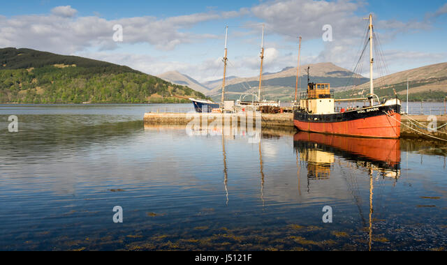 Inveraray, Scotland - May 13, 2016: The Vital Spark, a famous 'Clyde Puffer' boat, is moored at Inveraray - Stock Image