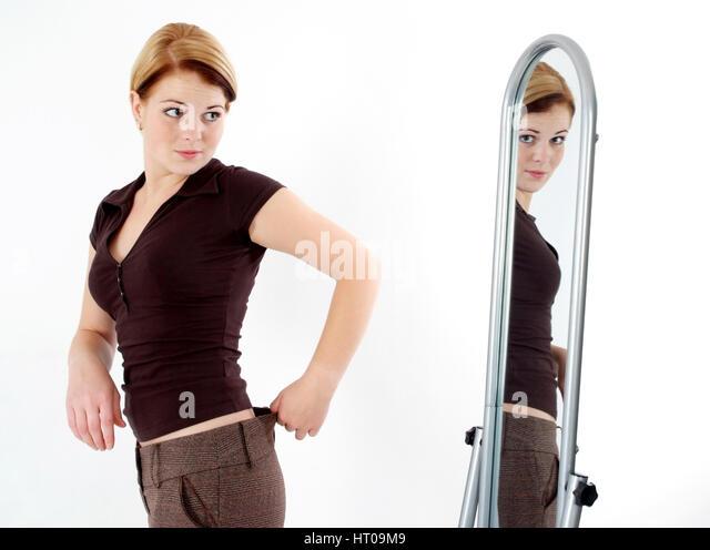Fat woman mirror stock photos fat woman mirror stock for Spiegel kinderzimmer junge