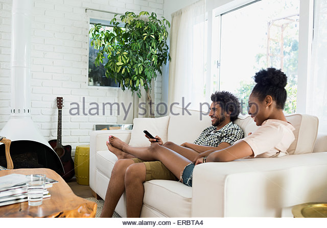 Living Room With Tv And People watching tv feet up stock photos & watching tv feet up stock