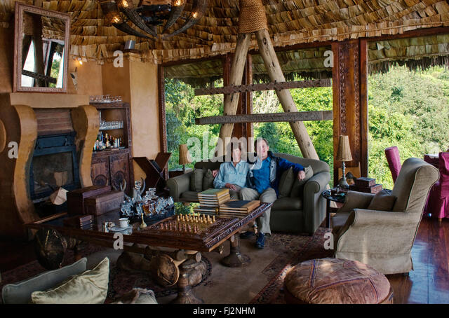 Guests Enjoy The Luxurious Sitting Room At Five Star NGORONGORO CRATER LODGE