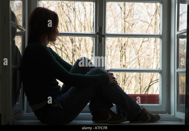 Sad Girl Looking Out Window Images