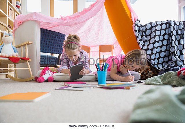 Girls Coloring Inside Living Room Fort