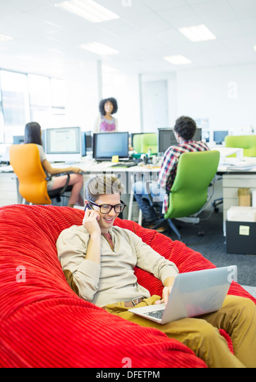 Businessman Working In Beanbag Chair Office