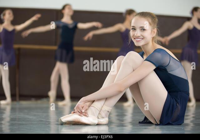 Teenage ballerina sitting on floor stock photos teenage for Dance where you sit on the floor