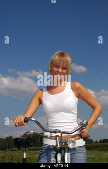 stock photo young blonde woman chat mobile phone junges blondes mdchen telefonierend