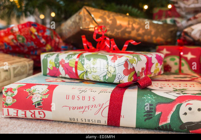 colourful xmas presents under a traditional real christmas tree stock image - Xmas Presents